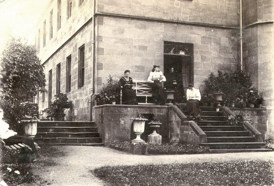 Group of ladies reading and relaxing outside Cherington House [?].  1894 |  IMAGE LOCATION: (Warwickshire County Record Office)