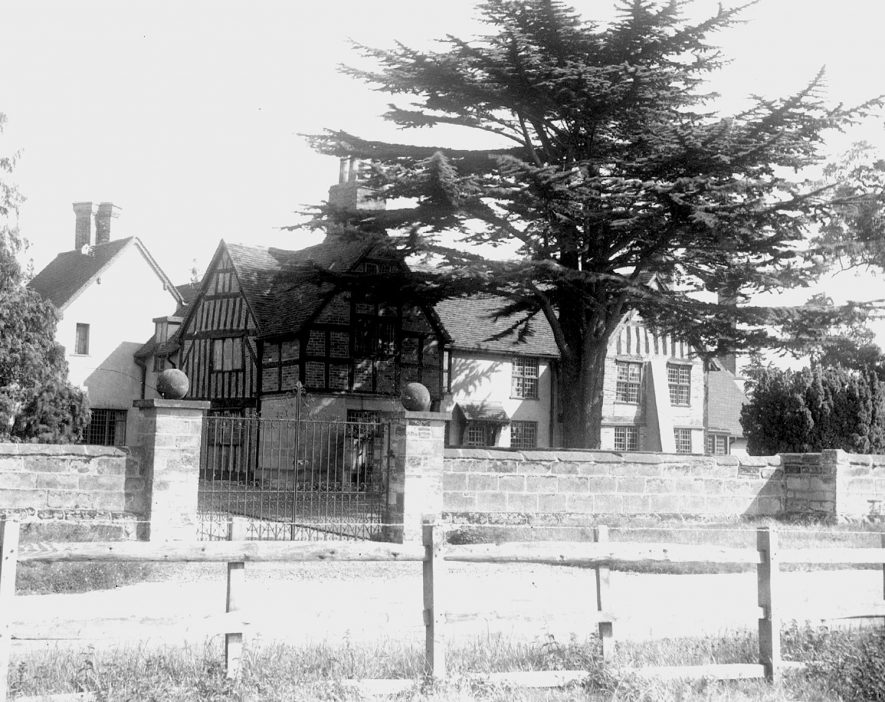 A timber framed house [Claverdon Hall] in Claverdon.  1900s    IMAGE LOCATION: (Warwick Library)