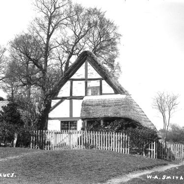 Hampton Lucy.  Timber framed thatched cottage