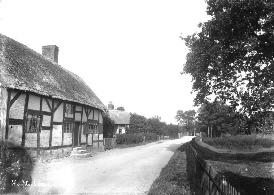 A timber framed thatched cottage in Hampton Lucy.  1900s |  IMAGE LOCATION: (Warwickshire County Record Office)