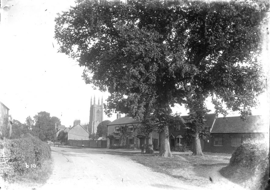 View of church and houses in Hampton Lucy.  1900s |  IMAGE LOCATION: (Warwickshire County Record Office)