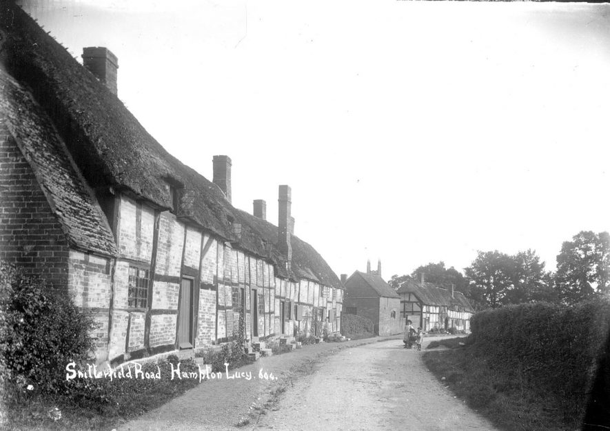 Row of thatched, timbered cottages in Snitterfield Road (now Street), Hampton Lucy.  1900s |  IMAGE LOCATION: (Warwickshire County Record Office)