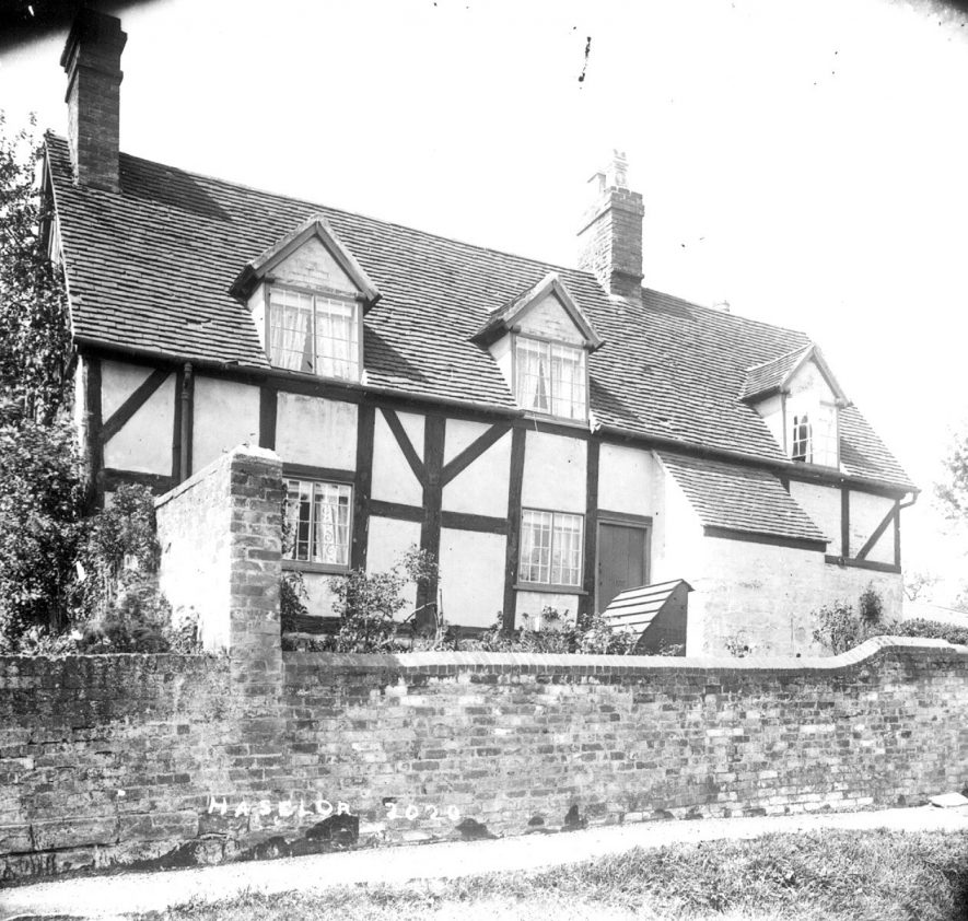 A timber framed cottage previously used as the post office in Haselor.  1900s |  IMAGE LOCATION: (Warwickshire County Record Office)