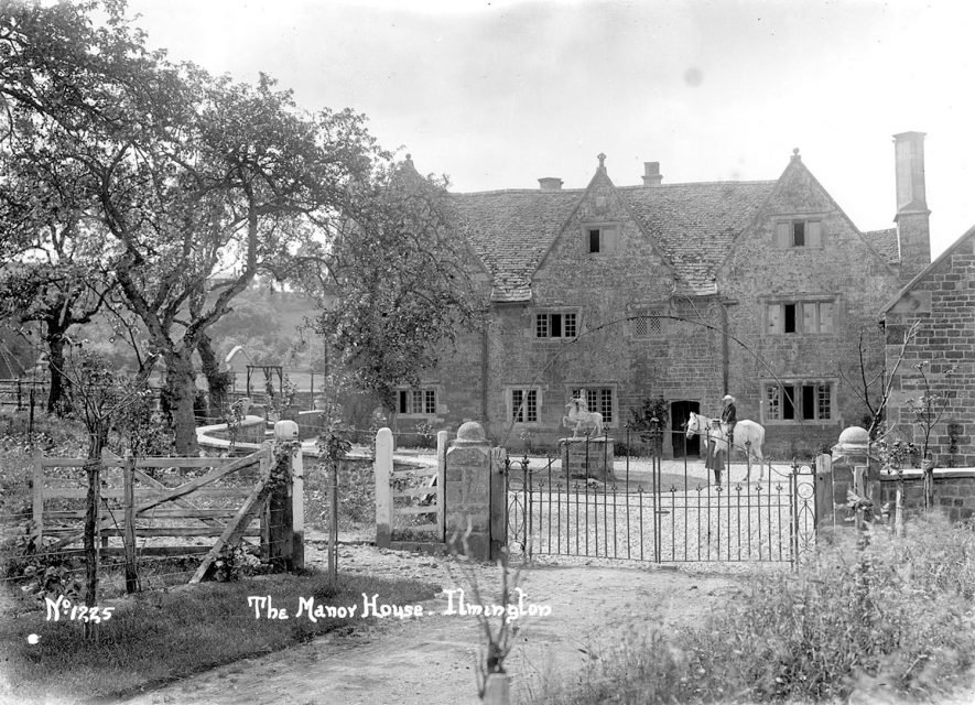 The Manor House, Ilmington. A lady is sitting astride a horse in front of the house.  1900s |  IMAGE LOCATION: (Warwickshire County Record Office)