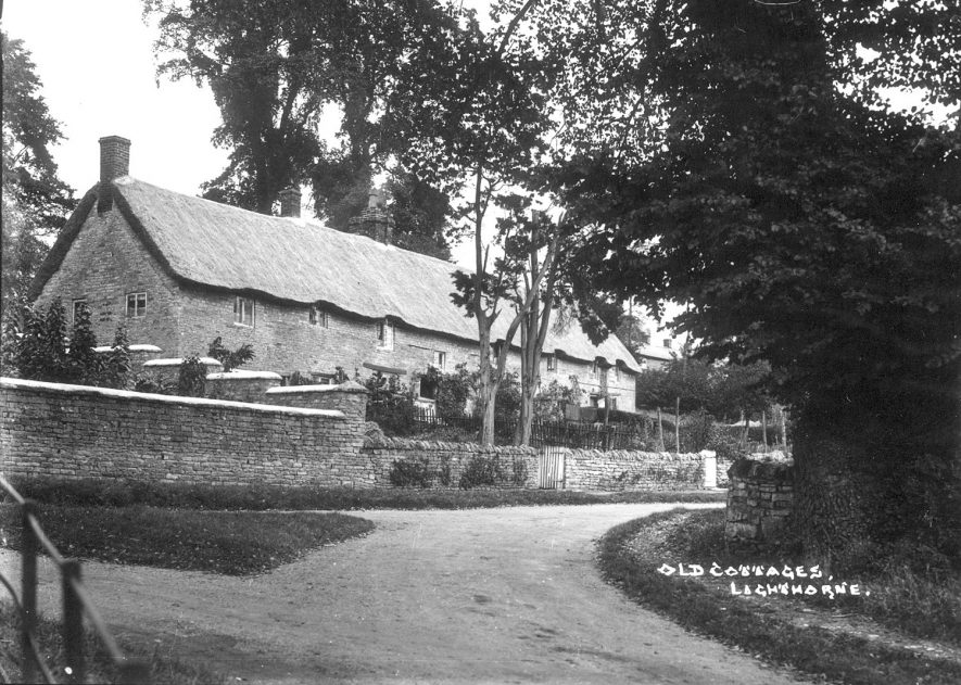 A row of old thatched cottages in Lighthorne.  1930s