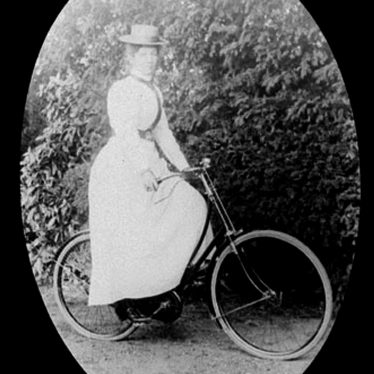 Brailes, Lower.  Mrs Findlay on a bicycle