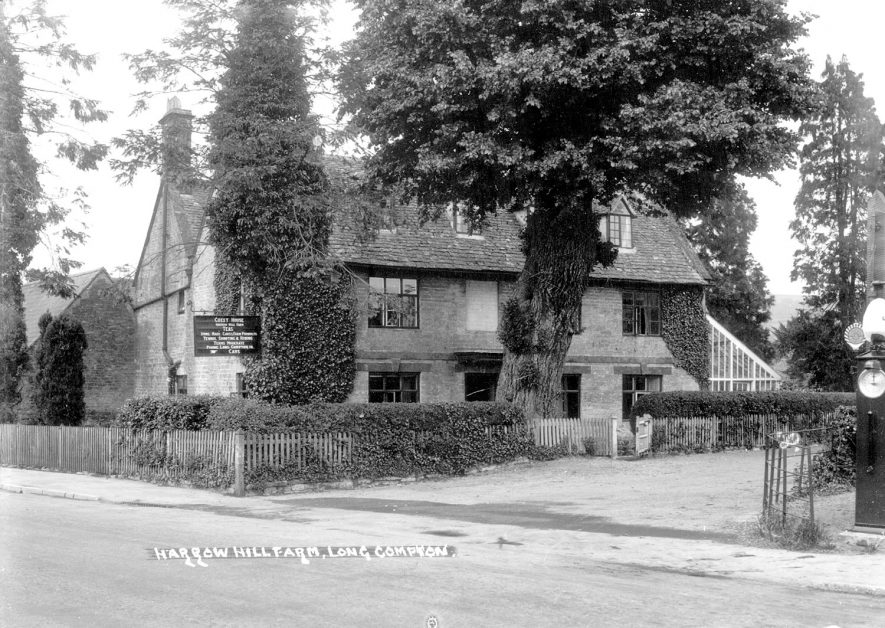 Harrow Hill farm and guest house, Long Compton. On the right of the picture is an old Shell petrol pump.  1930s |  IMAGE LOCATION: (Warwickshire County Record Office)
