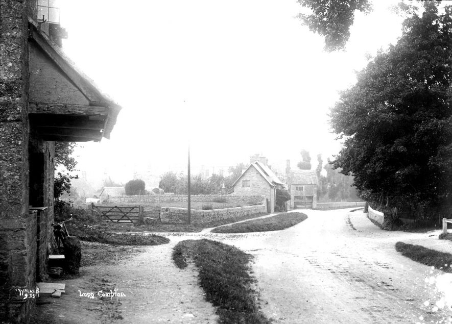 Saints Peter and Paul church and cottages, Long Compton.  1930s |  IMAGE LOCATION: (Warwickshire County Record Office)
