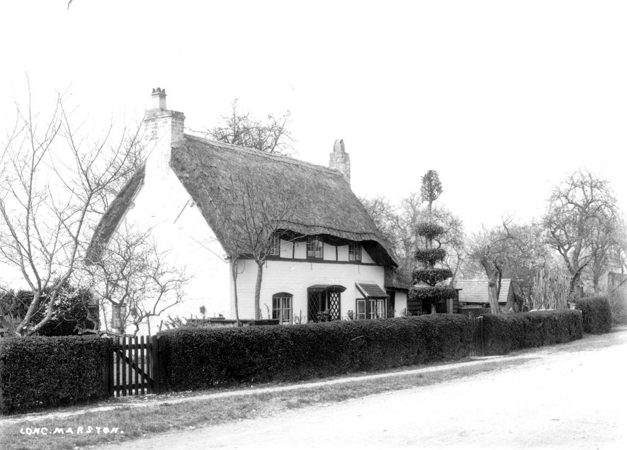 A thatched cottage in Long Marston.  1900s |  IMAGE LOCATION: (Warwickshire County Record Office)