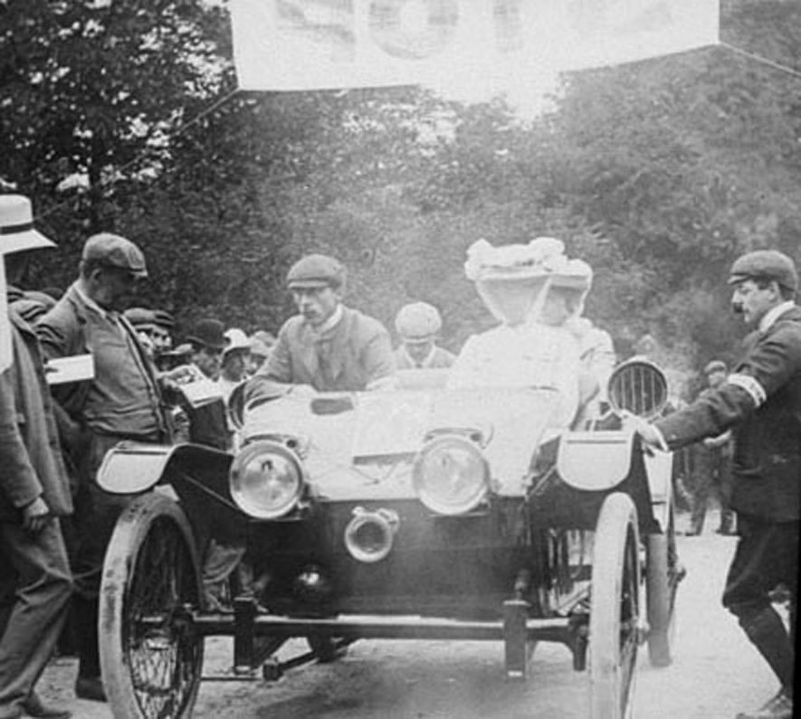 Edgehill. Finish of  a motor rally showing a car with driver and passengers.  A crowd of people looking on.  1903 |  IMAGE LOCATION: (Warwickshire County Record Office)