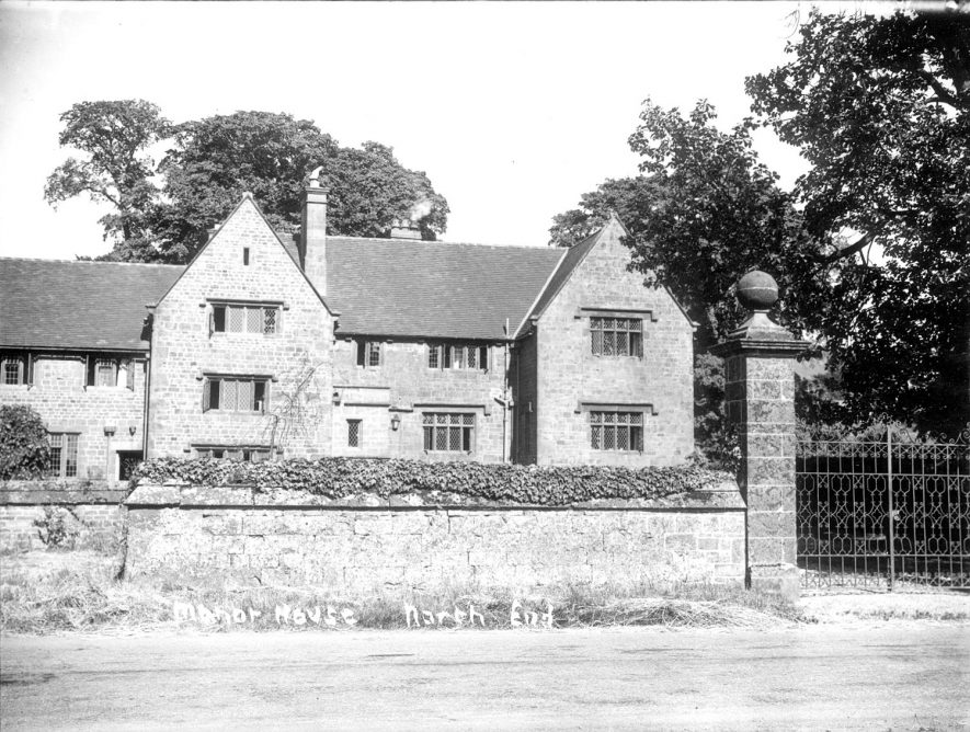 The Manor House, North End.  1910 [The wing on the left of the picture was added during the 1920's following a fire which gutted the centre part of the house. The floor arrangement of the centre part of the house was apparantly changed following the fire in which the cook who had a small room at the top, perished, having returned upstairs to recover some belongings. It is believed that the floor arrangements and number of floors in the centre part were altered at this time which could be ascertained by close examination of the stonework and window openings. The whole house had metal window frames and the work on the left hand wing was consistent with 1920's repro design] |  IMAGE LOCATION: (Warwickshire County Record Office)