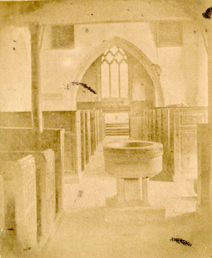 St Lawrence Church, Oxhill.  Interior showing the font before restoration in 1877.  1850s |  IMAGE LOCATION: (Warwickshire County Record Office)