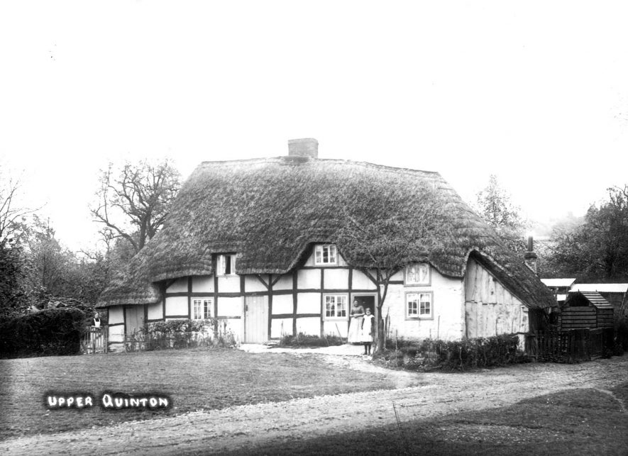 A timber framed thatched cottage in Upper Quinton.  1910s |  IMAGE LOCATION: (Warwickshire County Record Office)