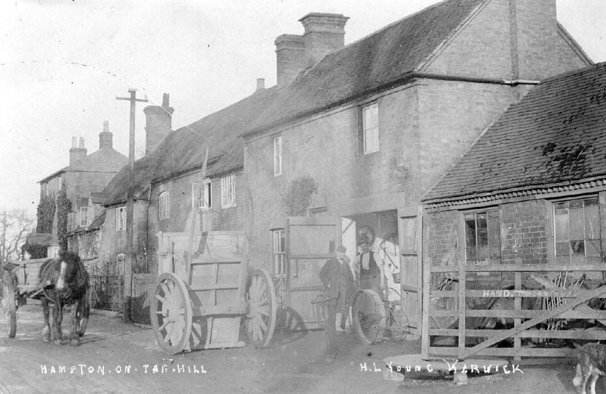 Hampton-on-the-Hill in the parish of Budbrooke. Houses and ? smithy with horse and trap and horse-cart.  1900s |  IMAGE LOCATION: (Warwickshire County Record Office)