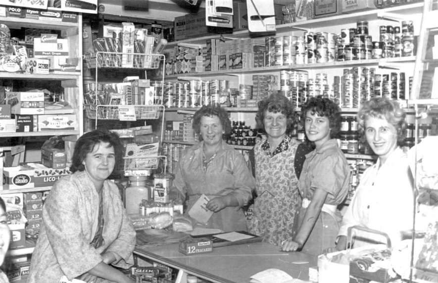 Wooding's shop, High Street, opposite the Ledbrook Hall, Cubbington. Pictured inside the shop are - Marion Pearce, Pam Lambert, Nell Richardson, Flossie Linden and Sheila Bass.  1950s |  IMAGE LOCATION: (Warwickshire County Record Office) PEOPLE IN PHOTO: Richardson, Nell, Richardson as a surname, Pearce, Marion, Pearce as a surname, Linden, Flossie, Linden as a surname, Lambert, Pam, Lambert as a surname, Bass, Sheila, Bass as a surname