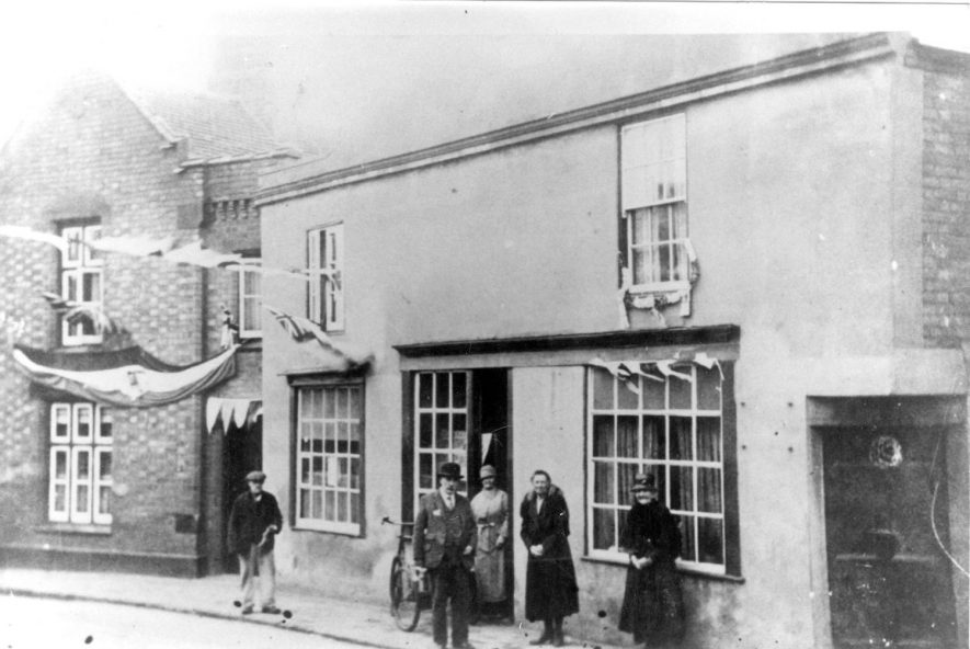 High Street, Cubbington during the Jubilee Celebrations.  Left to right:.  Dave Adkins, Oscar Penn,  Mrs. Bastock,  Mary Skelsey,  Mrs Tarver.  1936 |  IMAGE LOCATION: (Warwickshire County Record Office) PEOPLE IN PHOTO: Tarver, Mrs, Tarver as a surname, Skelsey, Mary, Skelsey as a surname, Penn, Oscar, Penn as a surname, Bastock, Mrs, Bastock as a surname, Adkins, Dave, Adkins as a surname