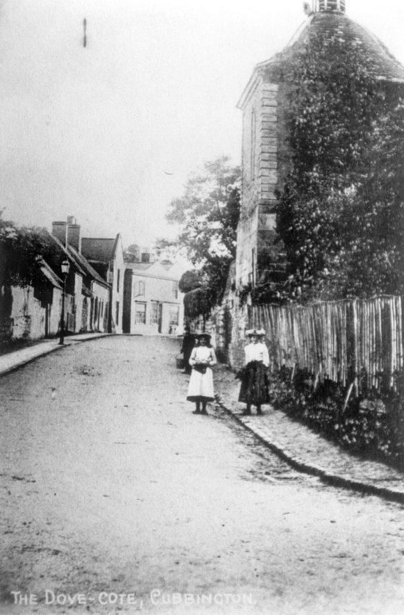 The Dovecote, High Street, Cubbington. Two girls are standing in the road in front.  1900s |  IMAGE LOCATION: (Warwickshire County Record Office)