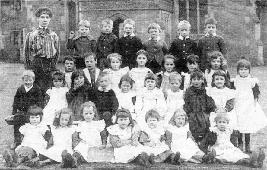 Cubbington School photograph. Back row: left-right. Miss Page ( teacher) E. Walden, F. Judd, F. Wainwright; third row l-r. L. Draper, J. Woodward, L. Walden, E. Heycock, A. Webb, L. Heycock, L. Robinson, second row; l-r. A. Butler, L. Harwood, Woodward, Wainwright, L. Butler, L. Stevens, L. Wells, Woodward, M. Muddiman, F. Mullis; front row left-right. L. Mullis, L. Stevens, A. Colin, L. Stevens, M. Mullis, L. Thornet, M. Colin.  Photograph reproduced in Morning News 18th March 1983. |  IMAGE LOCATION: (Warwickshire County Record Office) PEOPLE IN PHOTO: Woodward, J, Woodward as a surname, Wells, L, Wells as a surname, Webb, A, Butler as a surname, Webb as a surname, Walden, L, Walden, E, Walden as a surname, Wainwright, F, Wainwright as a surname, Thornet, L, Thornet as a surname, Stevens, L, Stevens as a surname, Robinson, L, Robinson as a surname, Page, Miss, Page as a surname, Mullis, M, Mullis, L, Mullis, F, Mullis as a surname, Muddiman, M, Muddiman as a surname, Judd, F, Judd as a surname, Heycock, L, Heycock, E, Heycock as a surname, Harwood, L, Harwood as a surname, Draper, L, Draper as a surname, Colin, M, Colin, A, Colin as a surname, Butler, L, Butler, A