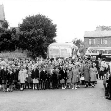 Cubbington.  Group of schoolchildren with coaches