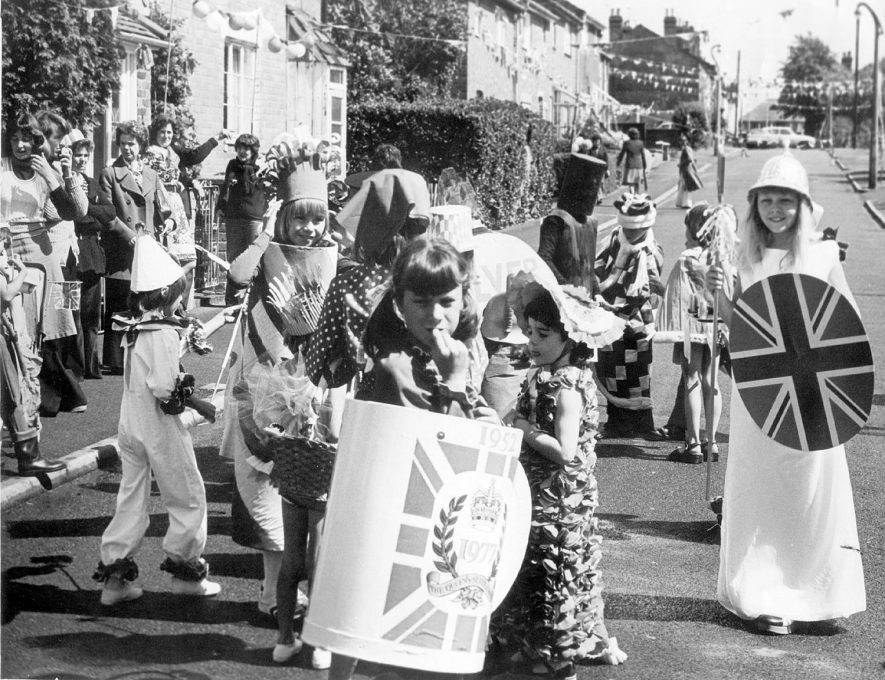 Silver Jubilee celebrations in High View Road, New Cubbington.  Children in fancy dress.  Children: Julie White, Karen Toozer, Lyn Walters, Karen Walters.  Adults: left-right. Lynne Thomas, Janet Robinson, Pat Collins & her mother, Maureen Mannen,  Roger White, Carole Butler.  1977 |  IMAGE LOCATION: (Warwickshire County Record Office) PEOPLE IN PHOTO: White, Roger, White, Julie, White as a surname, Walters, Lynn, Walters, Karen, Walters as a surname, Toozer, Karen, Toozer as a surname, Thomas, Lynne, Thomas as a surname, Robinson, Janet, Robinson as a surname, Mannen, Maureen, Mannen as a surname, Collins, Pat, Collins as a surname, Butler, Carole, Butler as a surname