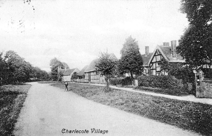 Village street in Charlecote with cottages and barns.  1900s |  IMAGE LOCATION: (Warwickshire County Record Office)