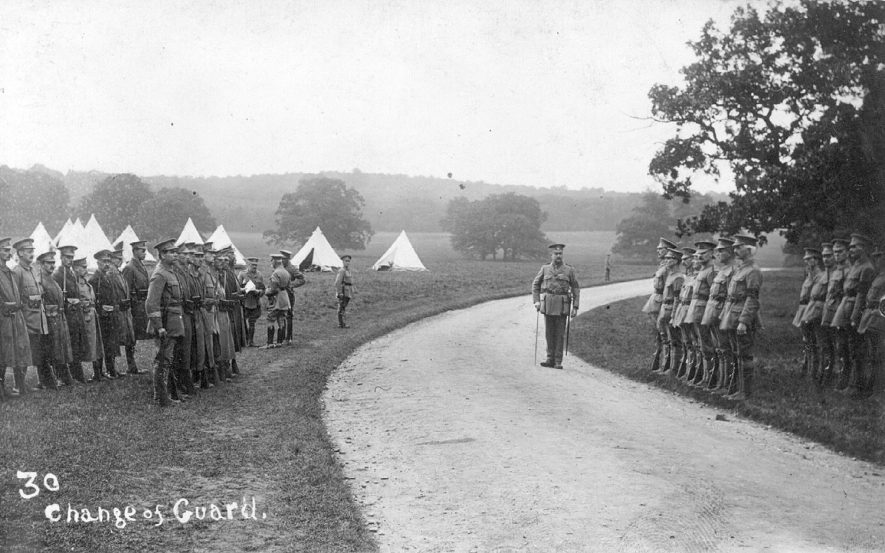 Soldiers changing guard at camp in Ragley Park, Arrow.  1915 |  IMAGE LOCATION: (Warwickshire County Record Office)