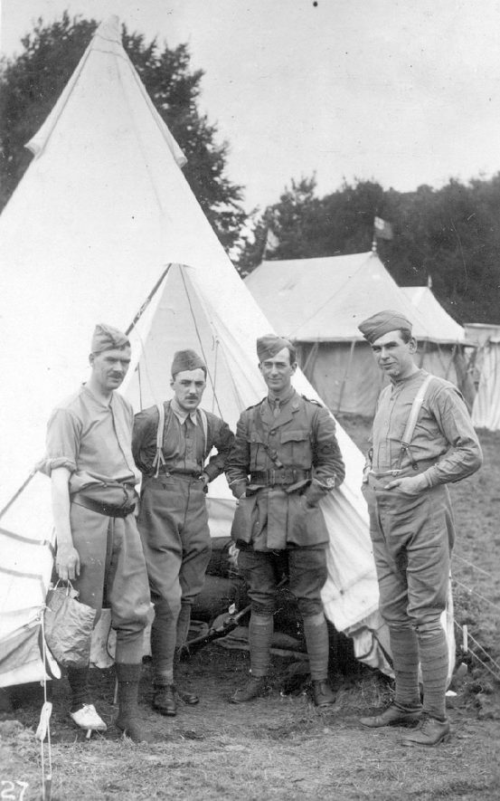 Four soldiers standing in front of a tent at Ragley Park, Arrow.  1915 |  IMAGE LOCATION: (Warwickshire County Record Office)