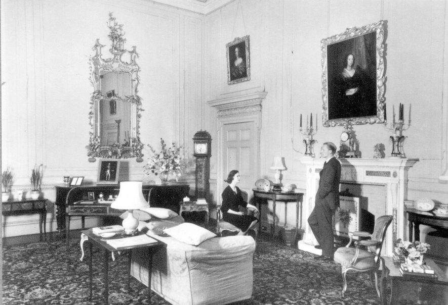 The Marquis and Marchioness of Hertford posing in the drawing room/saloon at Ragley Hall.  1950s |  IMAGE LOCATION: (Warwickshire County Record Office) PEOPLE IN PHOTO: Hertford, The Marchioness of, Hertford, The Marquis of