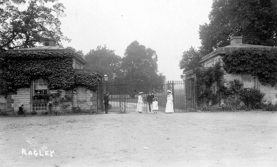 Wedding group standing at the lodge gates, Ragley Park.  1900s |  IMAGE LOCATION: (Warwickshire County Record Office)