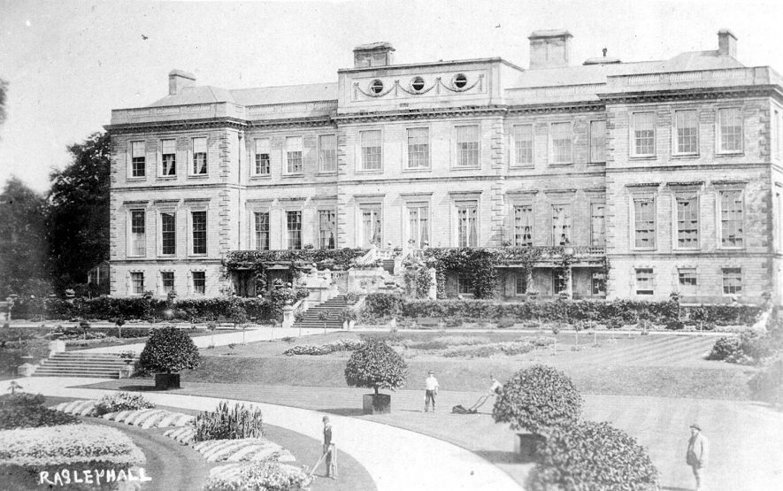 Exterior view of Ragley Hall and gardens. Gardeners are seen mowing the lawns and clipping the edges.  1900s |  IMAGE LOCATION: (Warwickshire County Record Office)
