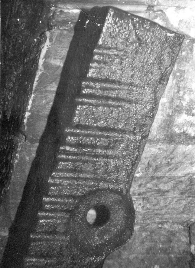 A soffit on a canal bridge at Rowington. This is typical of many bridges over canals. This iron band prevented the tow rope wearing into the masonry. Grooves in this example show how a rough rope can bite.  1950s |  IMAGE LOCATION: (Warwickshire County Record Office)