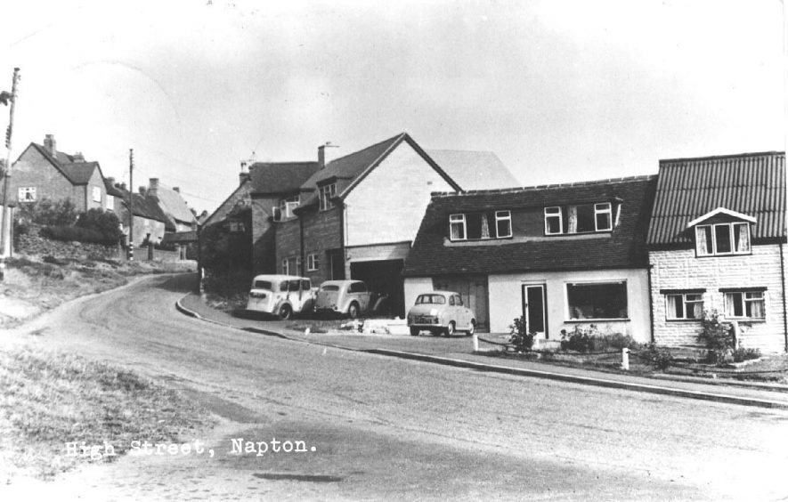 High Street, Napton on the Hill, with various cars in drives.  c.1960 [During the mid 1960's when this photograph was taken the shop was a butchers] |  IMAGE LOCATION: (Warwickshire County Record Office) IMAGE DATE: (c.1960)