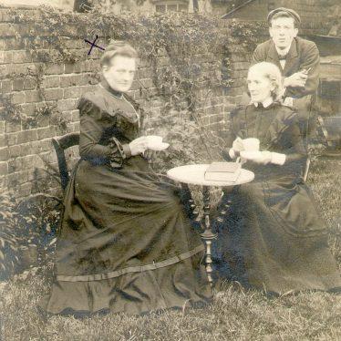 Stoneleigh.  Three people in garden
