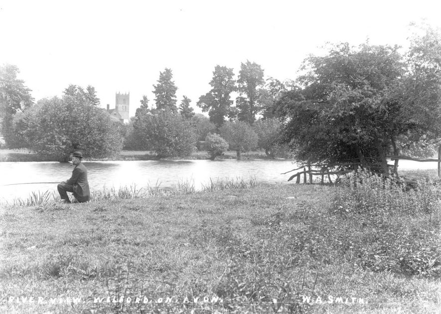 The River Avon at Welford on Avon with a man fishing.  1900 |  IMAGE LOCATION: (Warwickshire County Record Office)