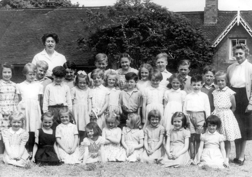 School group photograph. Back row, left to right - Mrs Mowforth, Alun Jones, Janet Barnes, John Boswell, Ken Evans, Peter Haynes, Mrs Fox. Middle row - Barbara Boulton, Heather Evans, Roger Hein, David Morton, Michael Rose, Carol Lamb, Christine Hein, Iris Carrol, not known, not known, Olwen Jones, Janet Boulton, David Mucklow, Janet Lamb. Front row - Linda Hein, not known, not known, Sandra Evans, not known, Sylvia Evans, Iris Carrol, not known, Ann Cowlishaw. Offchurch.  1950s
