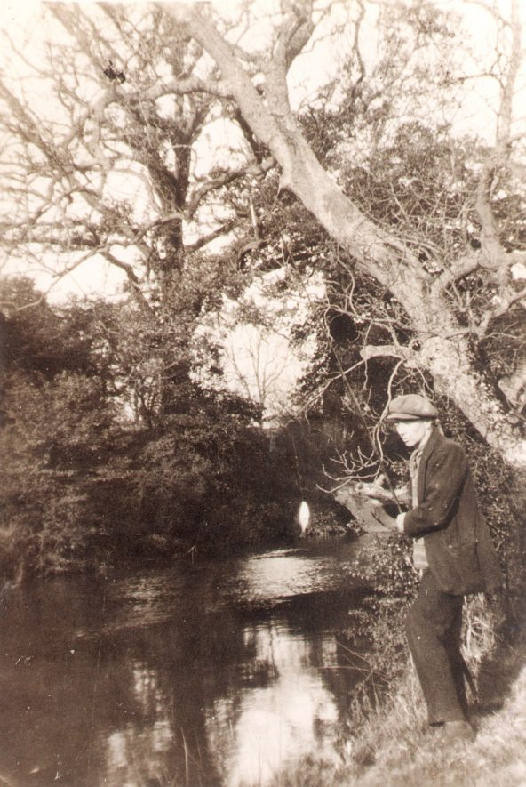 Alan Rose fishing from the river bank at Offchurch. 1920s |  IMAGE LOCATION: (Warwickshire County Record Office) PEOPLE IN PHOTO: Rose, Alan, Rose as a surname