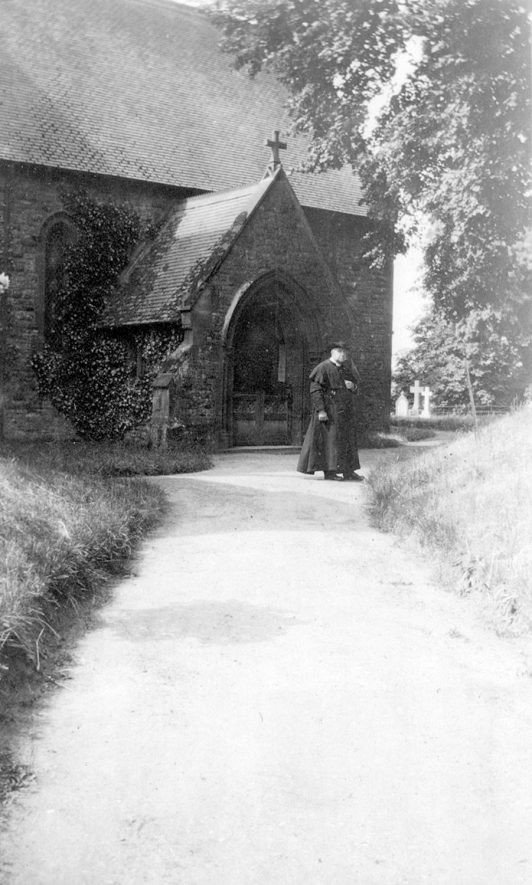 Mr. Morgan outside St Mary and Holy Cross church, Alderminster.  1930s |  IMAGE LOCATION: (Warwickshire County Record Office) PEOPLE IN PHOTO: Morgan, Mr, Morgan as a surname