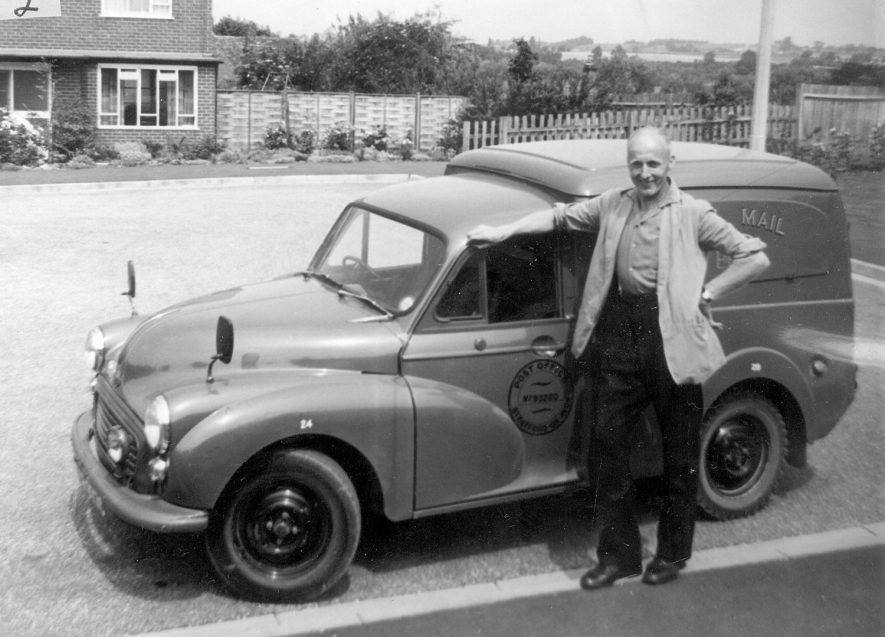 The village postman standing in front of his van in Alveston.  1967 |  IMAGE LOCATION: (Warwickshire County Record Office)