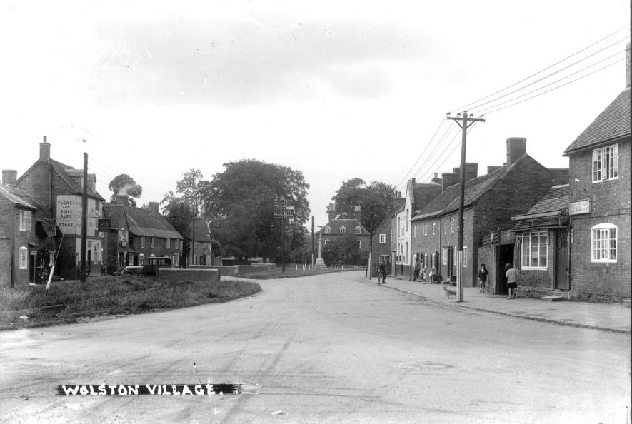 A village street, showing cottages, shop, public house and war memorial, Wolston.  1930s |  IMAGE LOCATION: (Warwickshire County Record Office)