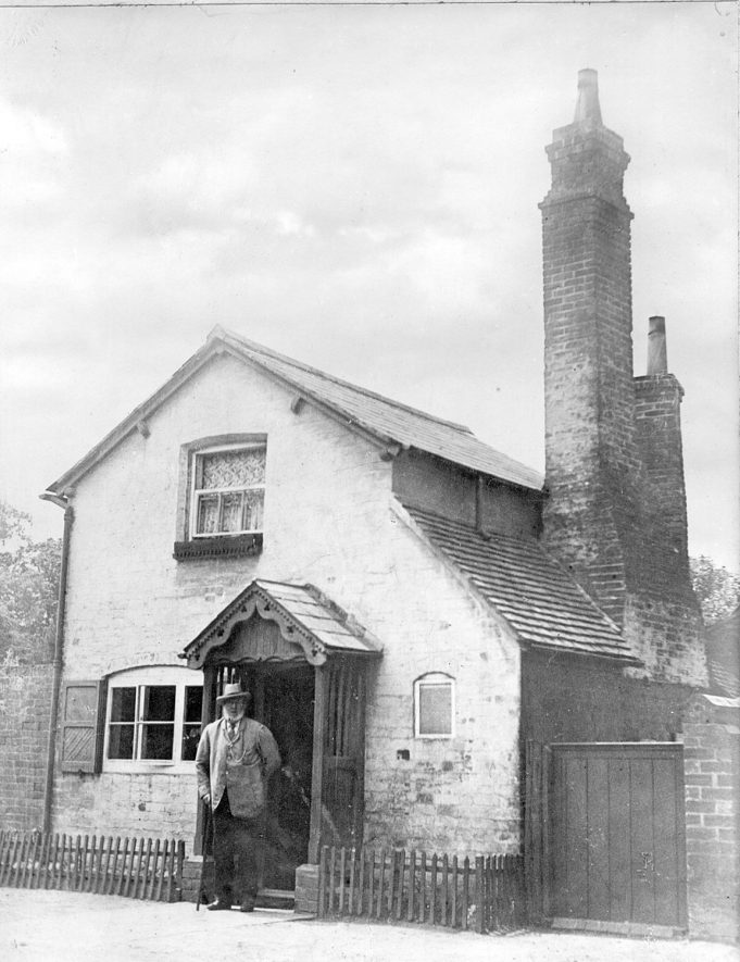 Joseph Arch, leader of agricultural workers, at doorway of a cottage in Barford. He was born in 1826 and died 1919. |  IMAGE LOCATION: (Rugby Library)