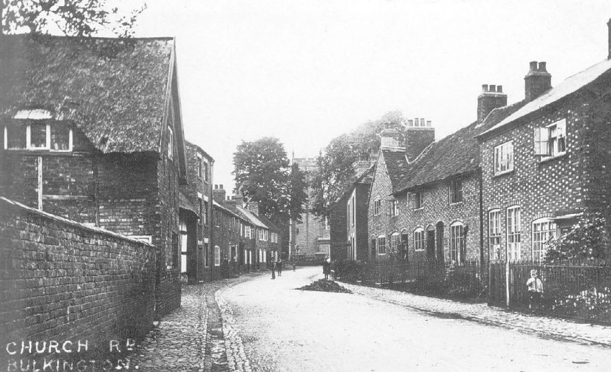 Houses in Church Road, Bulkington with church at the end of the road.  1930s |  IMAGE LOCATION: (Warwickshire County Record Office)