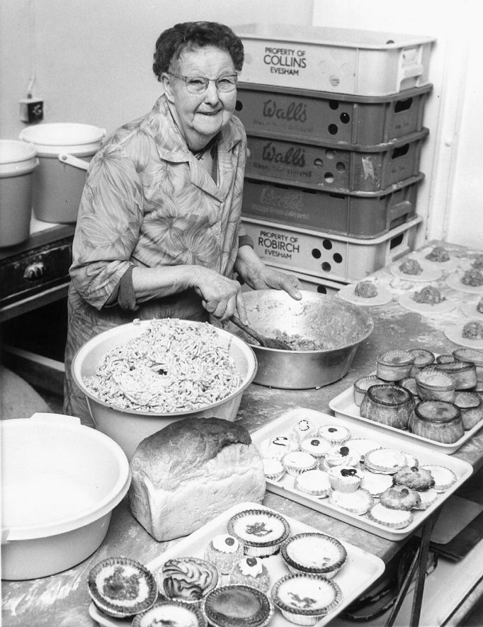 Mrs Bertha Buckle, aged 84, who had worked at Granny's Pies for 30 years when this photograph was taken, Bilton. 1971Photograph supplied by kind permission of the Rugby Advertiser. |  IMAGE LOCATION: (Rugby Library) PEOPLE IN PHOTO: Buckle, Bertha, Buckle as a surname