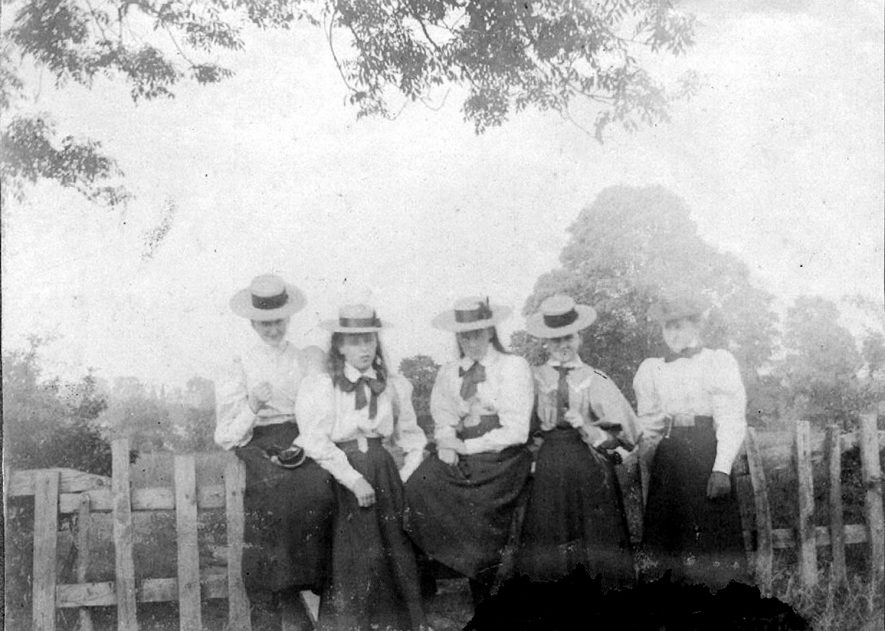 Agatha Mary Dewar and Hester Evelyn Dewar,  with two of the Donkins and governess.  Photograph taken on the site of Harris School [1958], formerly Laurels School playing field.  Both sets of girls were the daughters of assistant masters at Rugby School.  Miss A.M. Dewar married Captain Frank West of Bilton on 2nd June 1909, who was killed in action on 29 September 1916.  Then in 1924 Mr Randall G. Hosking.  1900s