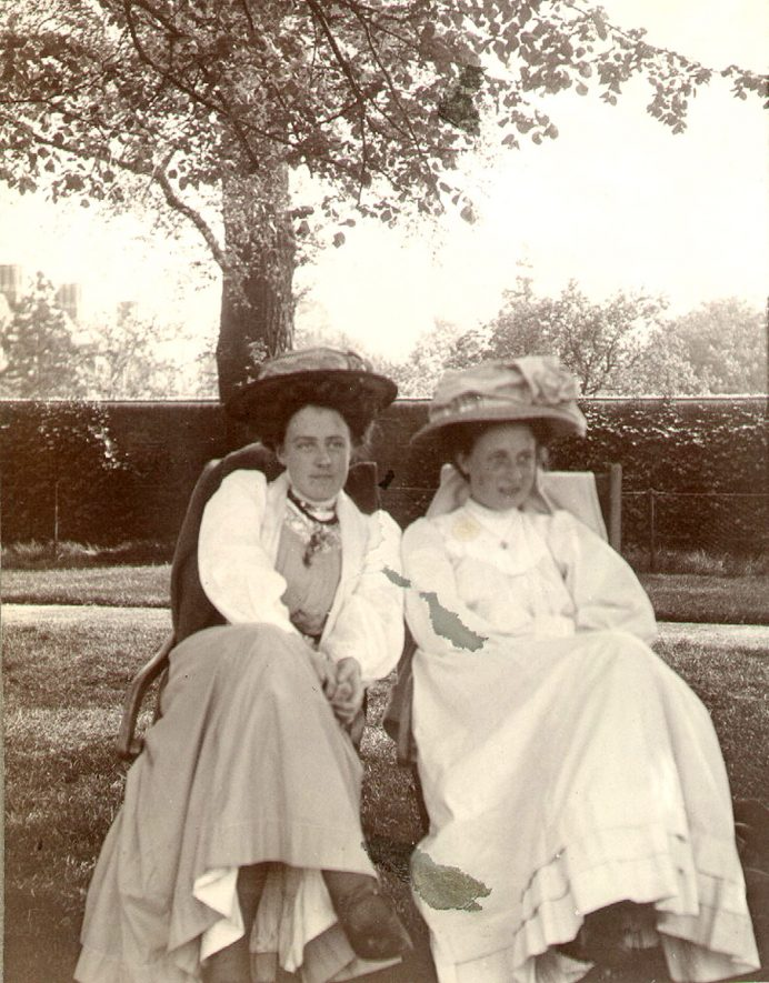 Miss A.M. Dewar, on the left, taken on School Close, the lady on the right is only known as E.M.C.  Rugby.  1900s |  IMAGE LOCATION: (Rugby Library) PEOPLE IN PHOTO: Dewar, Agatha Mary, Dewar as a surname
