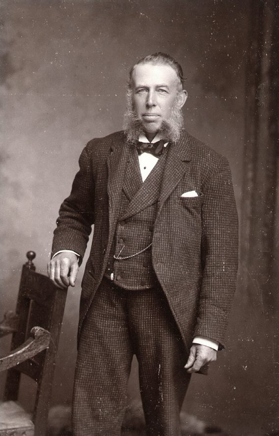 Joseph Foster, grocer, born in Rugby, 1845, died 1924. For many years, kept a grocer's shop at 20 Bridget Street.  Had an extensive knowledge of ailments of cats and dogs and treated animals all over the country.  One of the original members of Rugby Conservative Club, served on Committee, made a life member.  Also worker for Conservative party and staunch church attendee. Member of Rugby Board of Guardians 1910-1914.  (See Rugby Advertiser, May 7th 1924).  1900s |  IMAGE LOCATION: (Rugby Library) PEOPLE IN PHOTO: Foster, Joseph, Foster as a surname