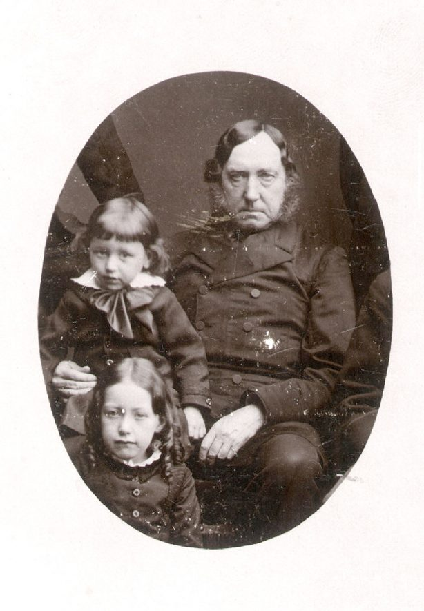 Studio portrait of Dr. Richard King and two small children. Dr King was born on 4th May 1819 and came to Rugby about 1867. He died in May 1882 and an obituary notice appears in the Rugby Directory of 1883, page 185.  1870s |  IMAGE LOCATION: (Rugby Library) PEOPLE IN PHOTO: King, Dr Richard, King as a surname