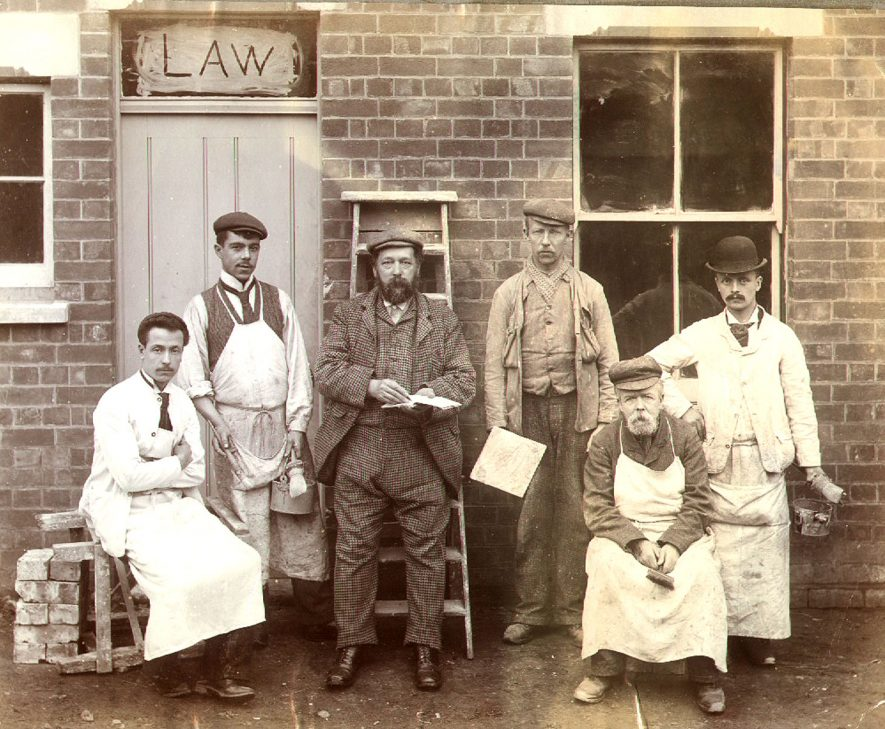 Mr Arthur Law and his workmen outside a house in Dale Street, Rugby. Arthur Law was in business as a painter and decorator from 1876 until 1904.  1890s |  IMAGE LOCATION: (Rugby Library) PEOPLE IN PHOTO: Law, Arthur, Law as a surname
