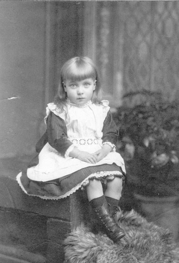 Studio portrait of a young girl believed to be Margaretta Law, daughter of Arthur Law, painter and decorator in Rugby from 1876 until 1904.  1890s |  IMAGE LOCATION: (Rugby Library) PEOPLE IN PHOTO: Law, Margaretta, Law as a surname