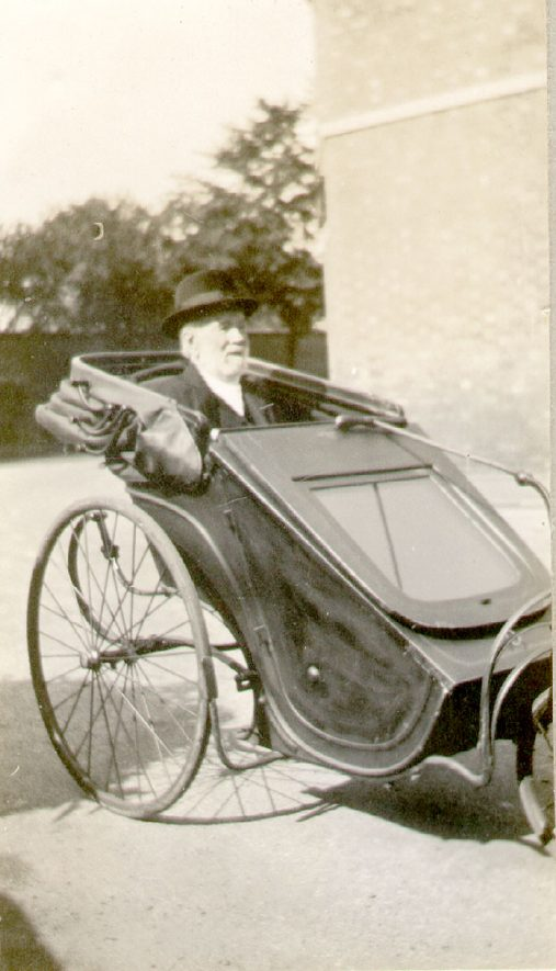 Mr Henry Lister in his bathchair in Rugby. Mr Lister was the first telegraph clerk at the L.M.S Station. This photograph was taken when Mr Lister was 100 years old in 1930.    IMAGE LOCATION: (Rugby Library) PEOPLE IN PHOTO: Lister, Henry, Lister as a surname
