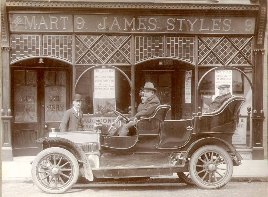 Mr James Styles, auctioneer (front seat),  Mr Arthur Low, painter and decorator (back seat) outside